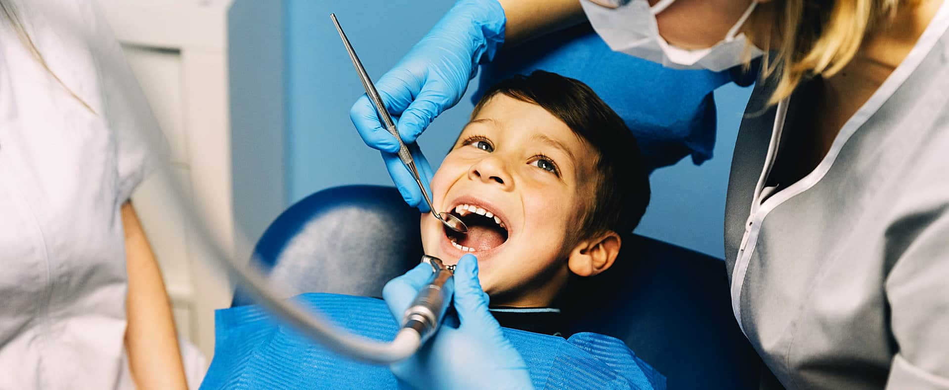 dentists checking the kid's teeth