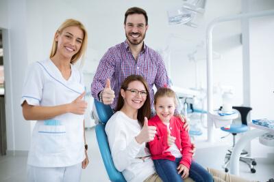 family visit their family dentist