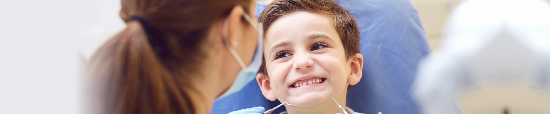kid smiling to his dentist